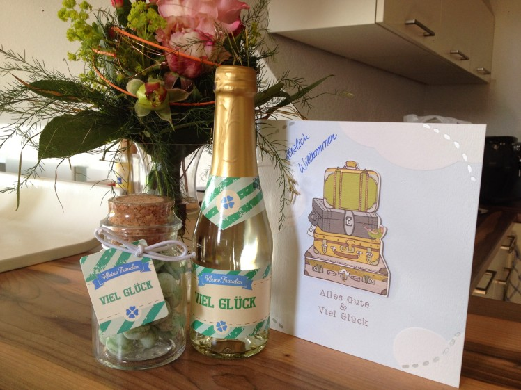 Champagne, Flowers, Candy, and a card signed by everyone welcoming me and wishing me good luck in my new job :-D